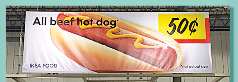 A photo of a billboard advertisement for 50-cent hot dogs at IKEA