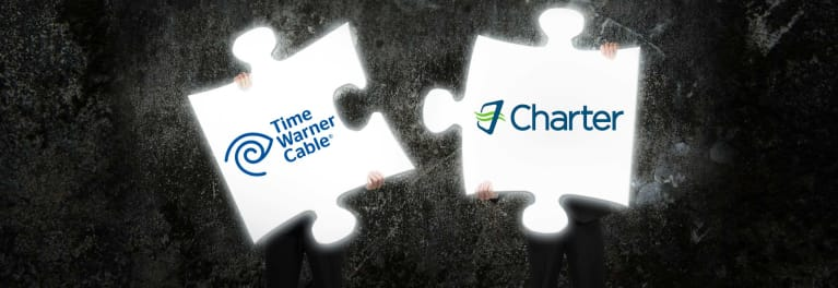 Puzzle pieces fitting together represent the Charter-Time Warner Cable merger.