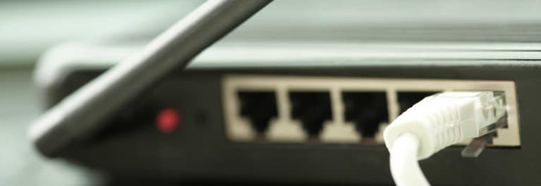 a close-up look at the ports on a Wifi router
