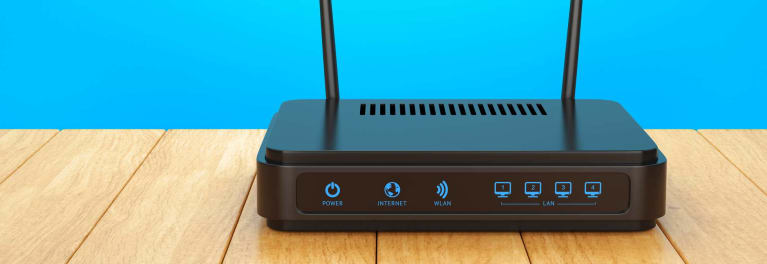 A wireless router on a table, for an article on router firmware.