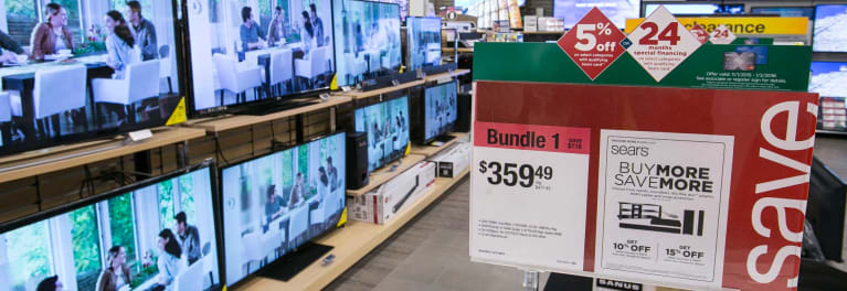 Photos of TVs at a Sears Black Friday sale.