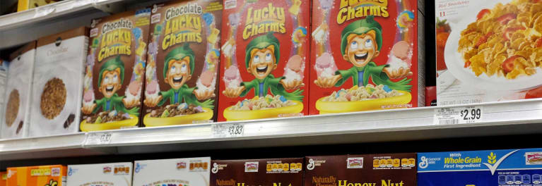 A supermarket shelf with General Mills cereals.