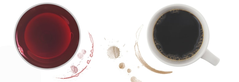 A glass of wine and a cup of coffee to illustrate the health benefits of coffee and wine.