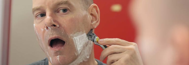 A man shaving. Shave clubs can provide good razors at low cost.
