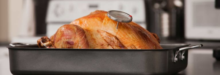 This turkey has a meat thermometer in it to test the temperature. Meat thermometers are more reliable than pop-up timers.