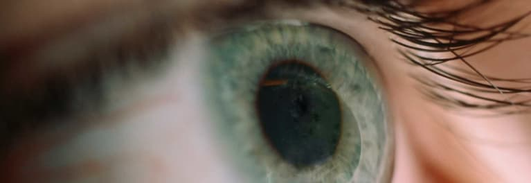 This is a close-up photo of an eye. Eye floaters can be a sign of vision issues.