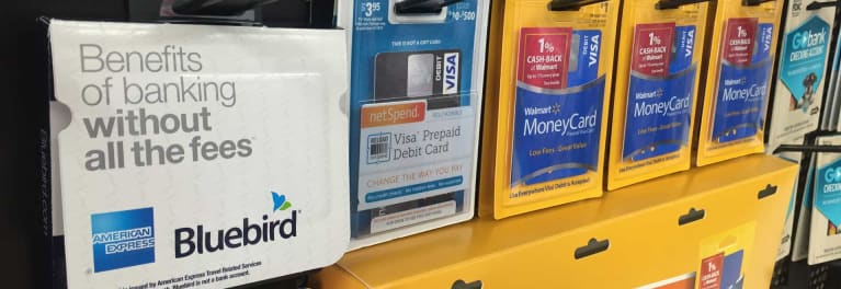 The top-rated Bluebird and other re-loadable prepaid cards on a sales rack at Walmart.