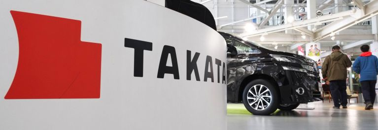 A photo of a Takata logo/airbag.