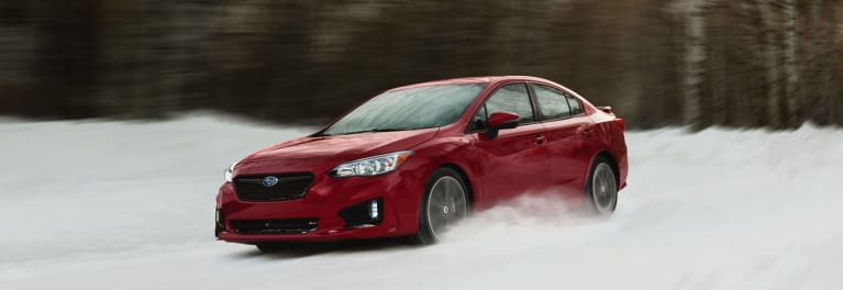 A 2018 Subaru Impreza driving on winter/snow tires