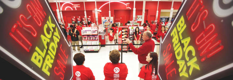 Sales clerks at Target preparing for a Black Friday sale