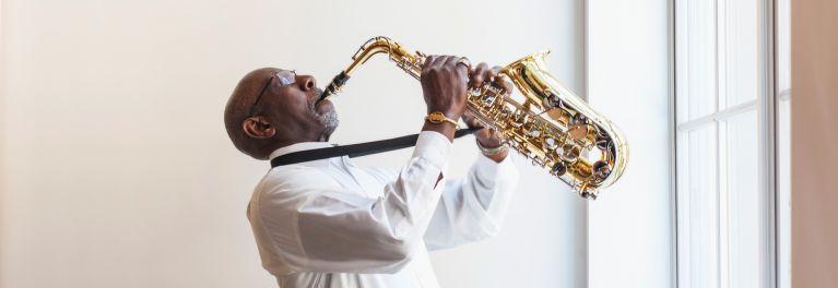 A man playing a saxophone.