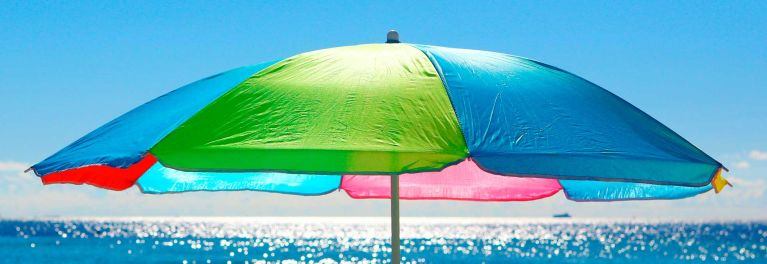 A beach umbrella is an important sun-safety tool.