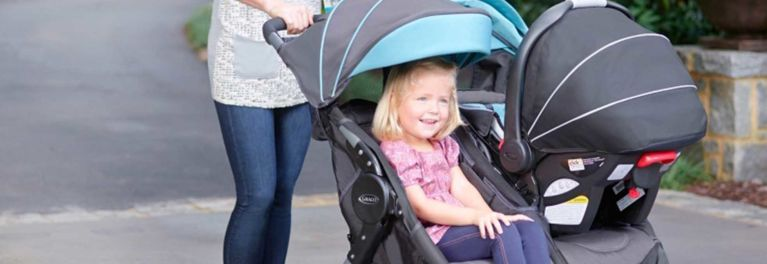 Two children in a double stroller.