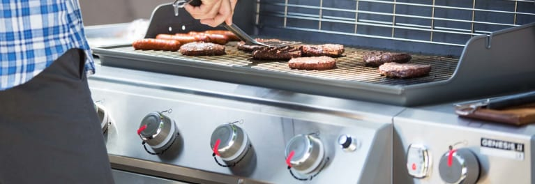 Cooking Burgers And Hot Dogs On A Gas Grill