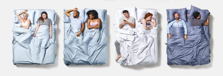 A photo of couples lying in bed