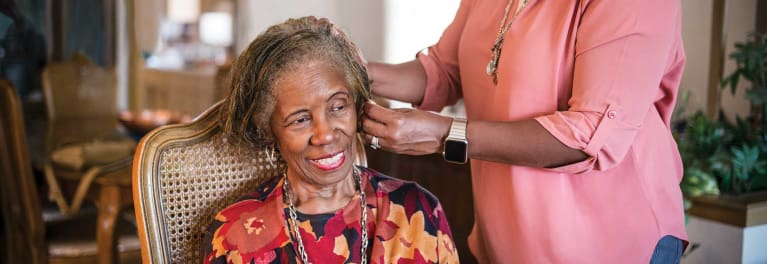 Hands-on care: Sherri Swansey helps her mom, Ruth Thompson, style her hair.