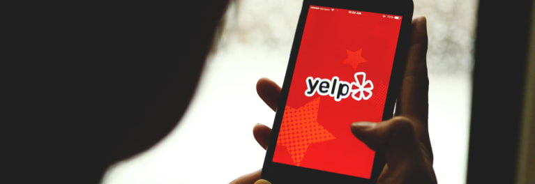 A person checks Yelp.