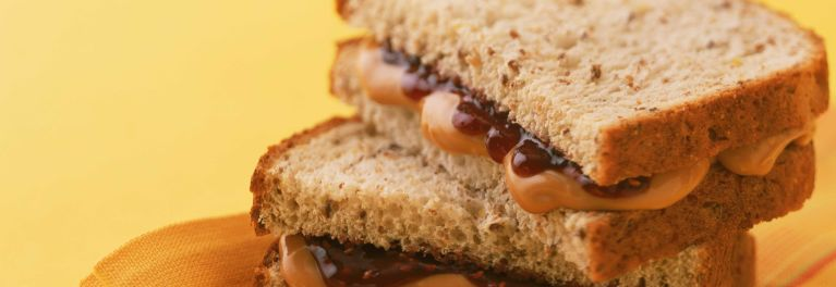 A peanut butter and jelly sandwich on wheat bread.