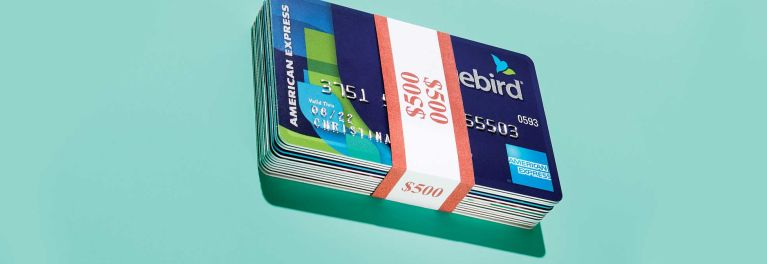 Stack of prepaid credit cards with a money wrap that says $500.