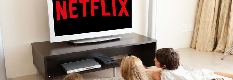 Photos of three youngsters watching a TV with the Netflix logo.