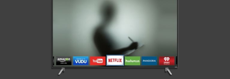 Image of a Vizio smart TV with a silhouette of a person taking notes in the background of the screen.