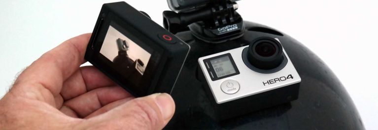 A photo of two GoPro action cams