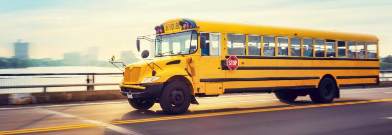 A yellow school bus on the highway.