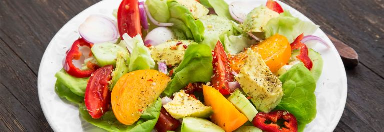 A salad made with a variety of vegetables. Salads are part of a plant-based diet.