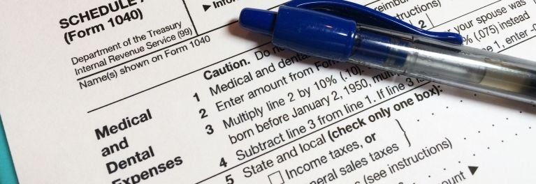 This is a photo of a tax form. It's important to consider medical tax deductions before filing taxes.