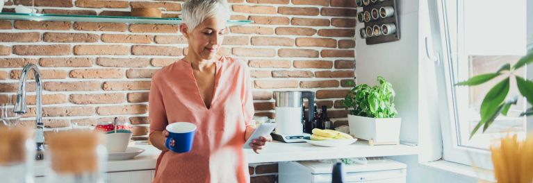 A white-haired woman with a coffee cup