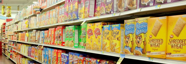 Cereal aisle in the supermarket. Cereal is sometimes a genetically engineered food.