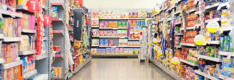 Supermarket shelves stocked with packaged foods.