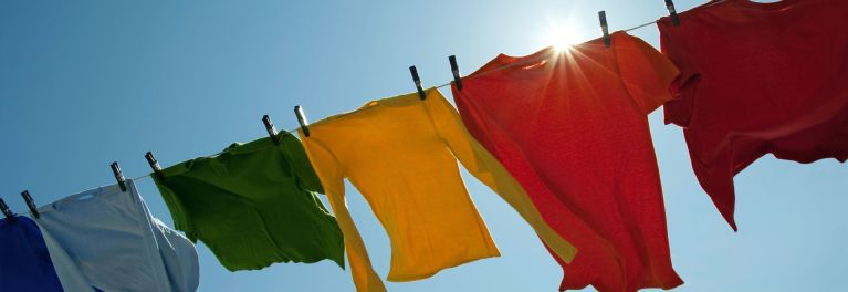 Colorful clothes hanging to dry on a clothes line.