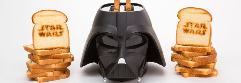 Darth Vader toaster and pieces of toast emblazoned with Star Wars logo.