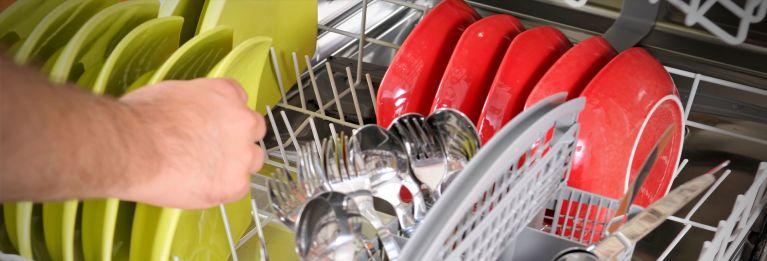 Someone loading a dishwasher.